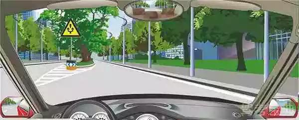 图中标志提醒障碍物在路中,车辆从两侧绕行。